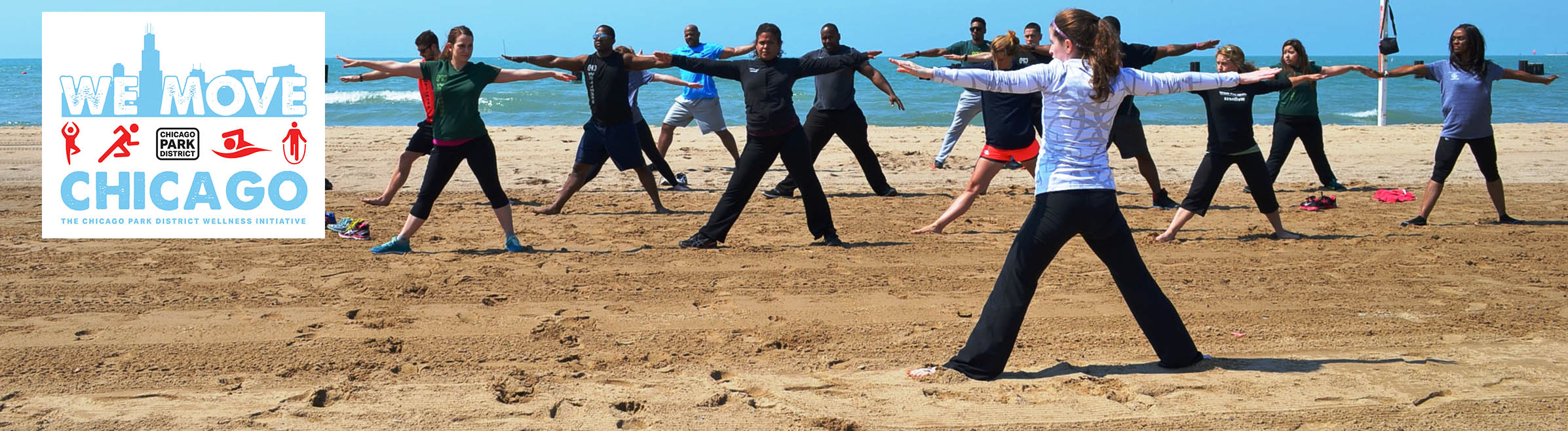 A group of adults enjoys a workout on the beach as part of the We Move Chicago program.