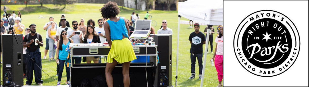 A woman DJ's in a park with a crowd of people gathered around to watch and enjoy.