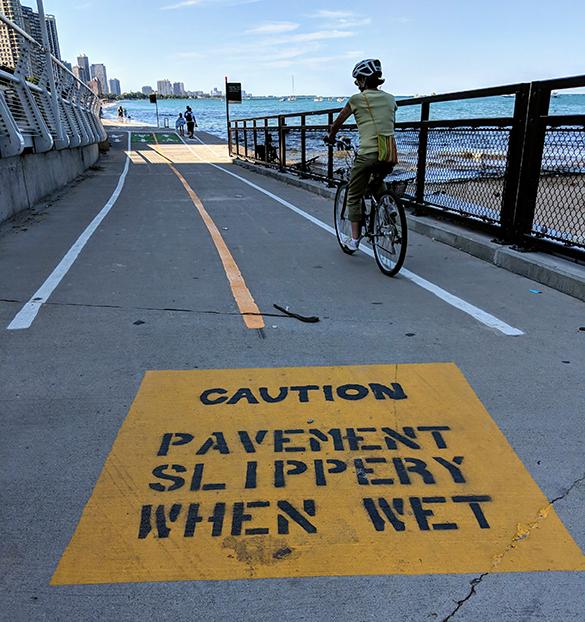 Caution Slippery Pavement