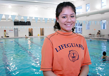 A Chicago Park District lifeguard photographed at an indoor park pool.