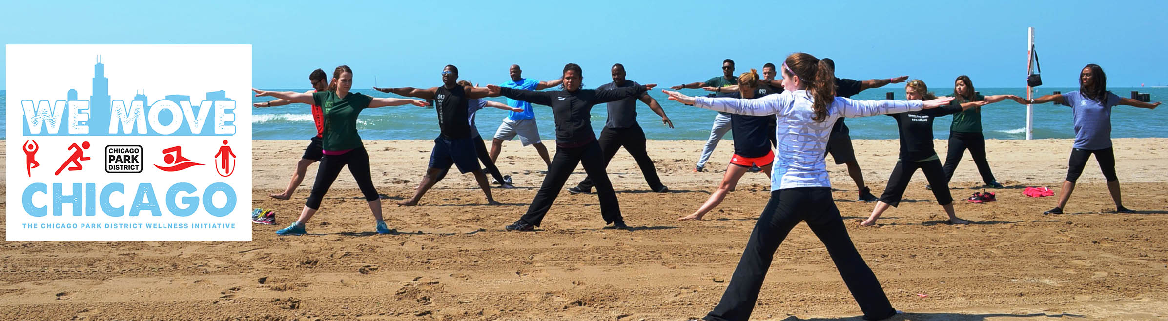 A group works out at the beach on a sunny day in a fitness class that is part of the We Move Chicago initiative.
