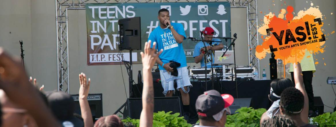 A large group of teens watch a performer at the annual T.I.P. Fest.