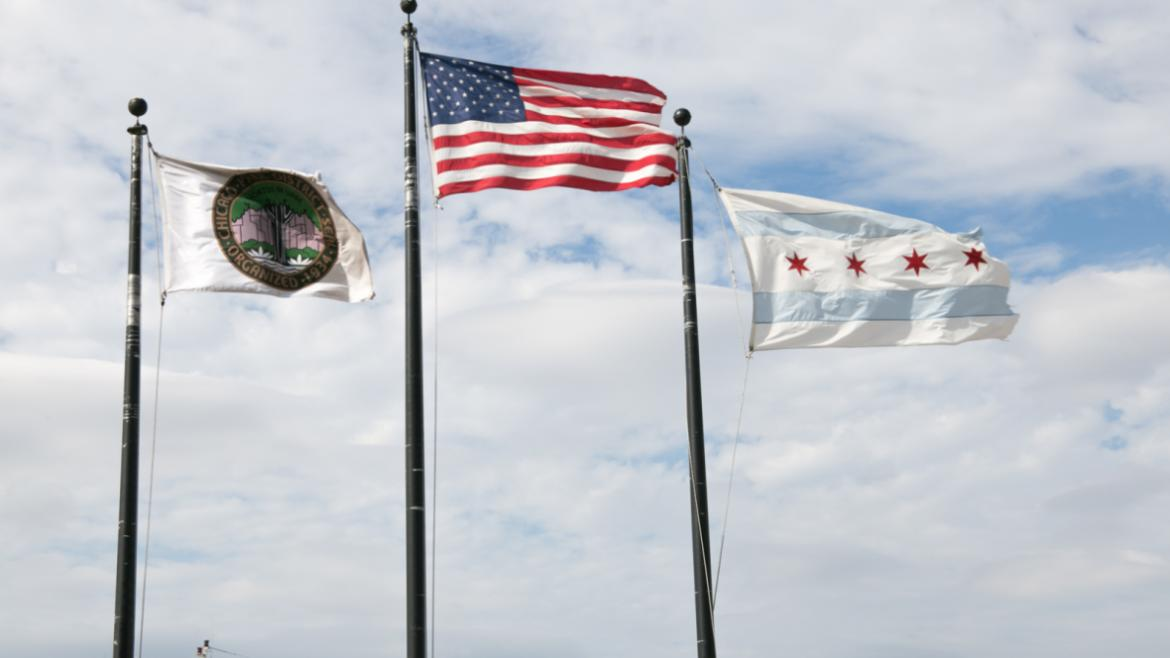 Chicago Park District, USA and Illinois Flags flying in the wind.