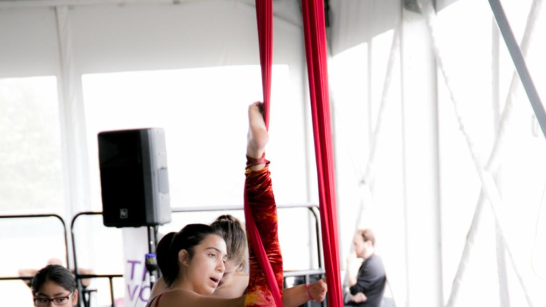 Acrobat performers doing aerial tricks.