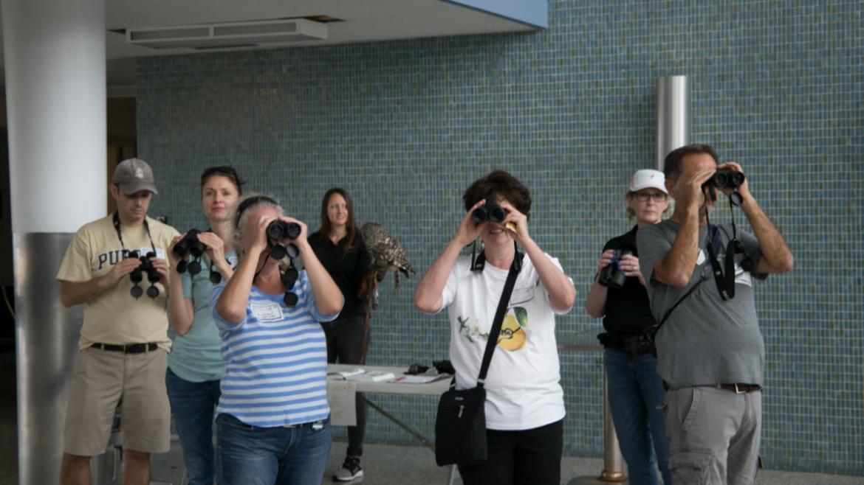 Volunteers exploring the art of bird watching.