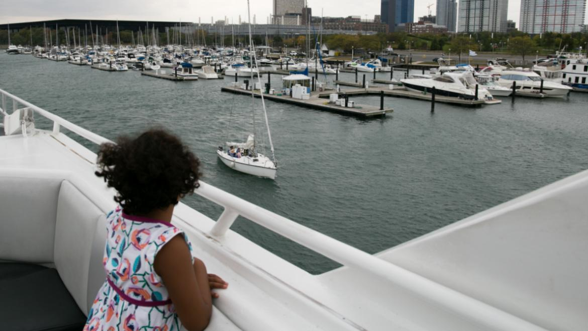 Young girl taking in the view from the deck of the Anita Dee II Yacht.