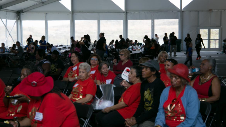 Volunteers sitting while listening to presentation.