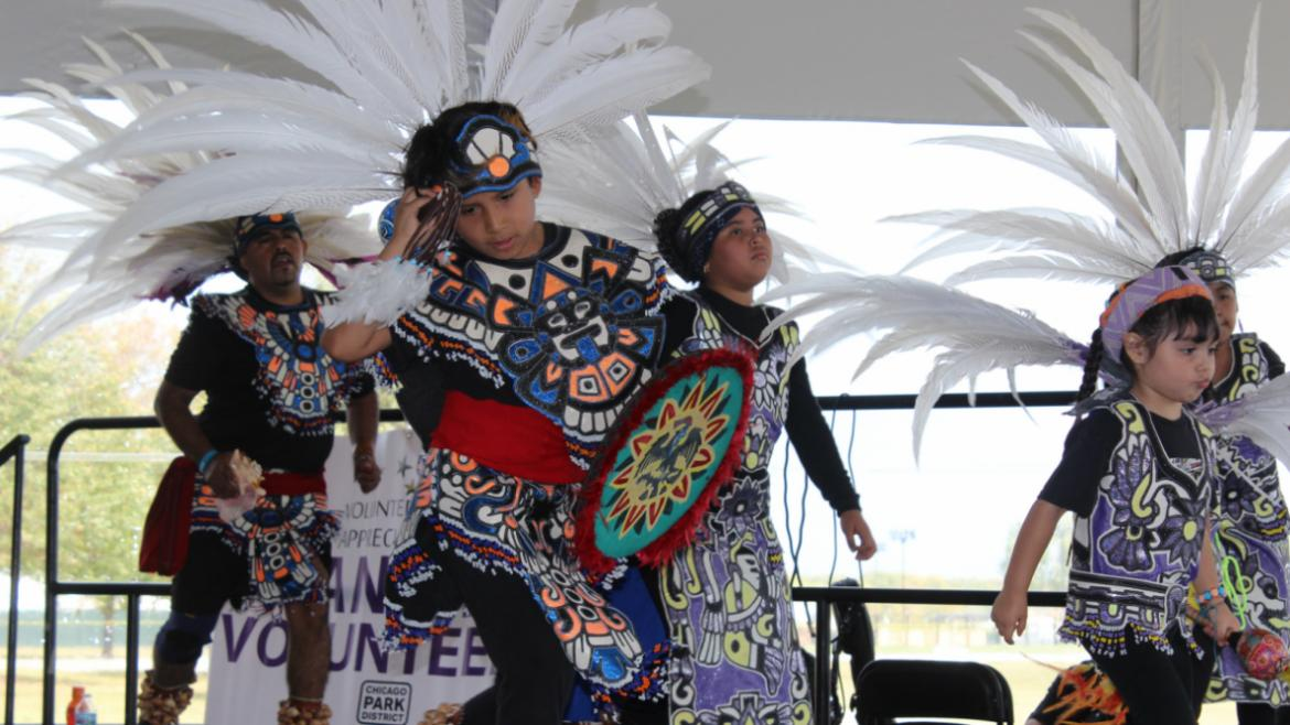 Tribal performance on the Volunteer Appreciation stage.