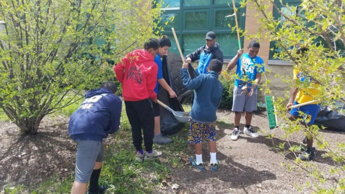 The cheerleading and football teams worked to clean and green Fosco Park!