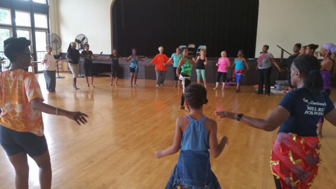 Khalidah Kali, center, teaching participants in Egyptian Belly Dance Saturday, July 11, 2015 at Full