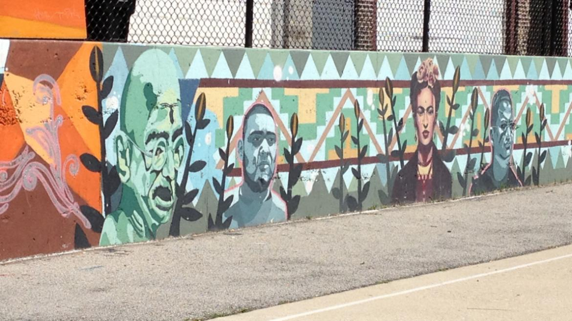 Other inspiring figures, such as Mahatma Gandhi (far left) and Frida Kahlo (right), are illustrated
