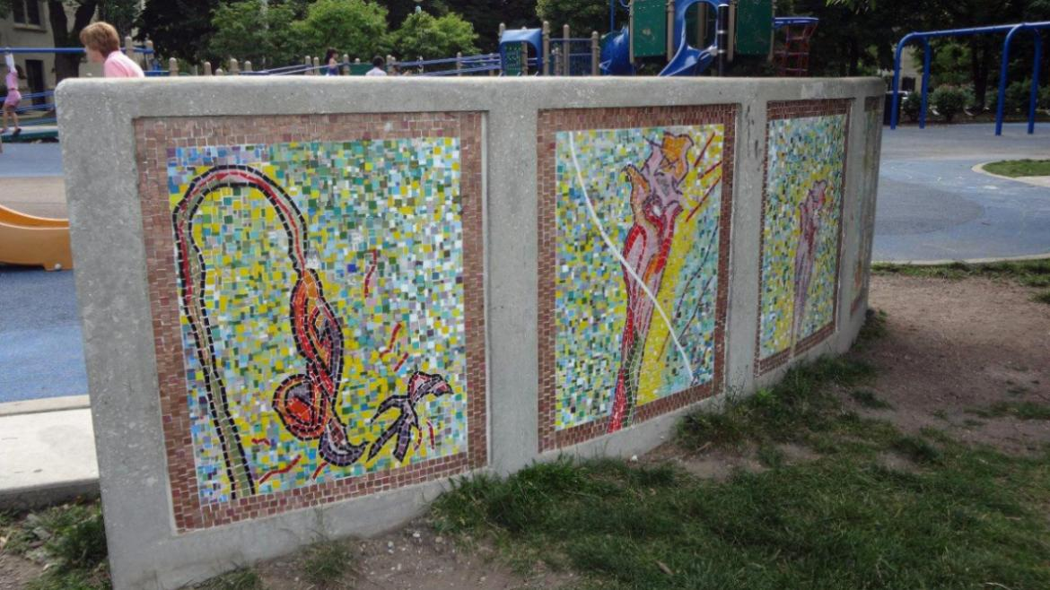 Each of the mosaic panels on the back side of the bench depicts a single flower.