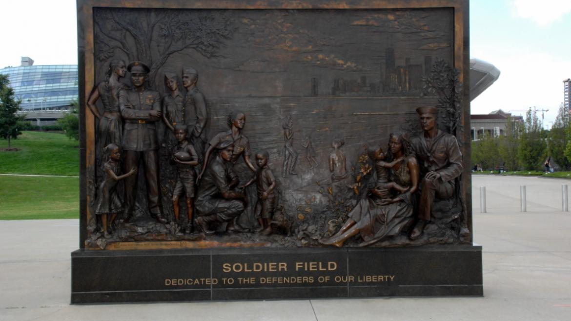 The Tribute to Freedom's bronze bas-relief panel depicts members of the Armed Services.