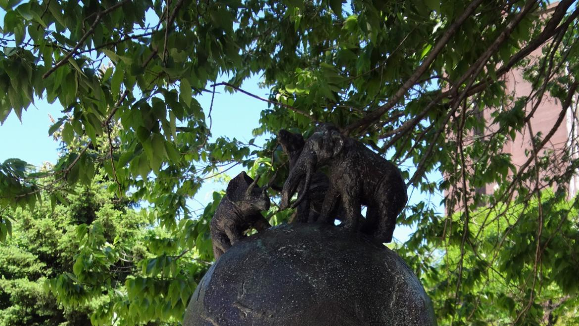 This version of the three sculptures has a globe of the earth topped with dinosaurs.