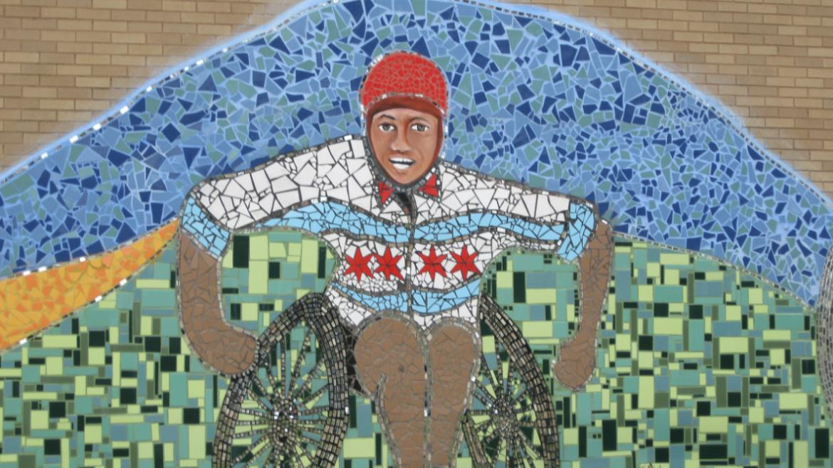 The broken tile mosaic includes a disabled athlete wearing a jacket .