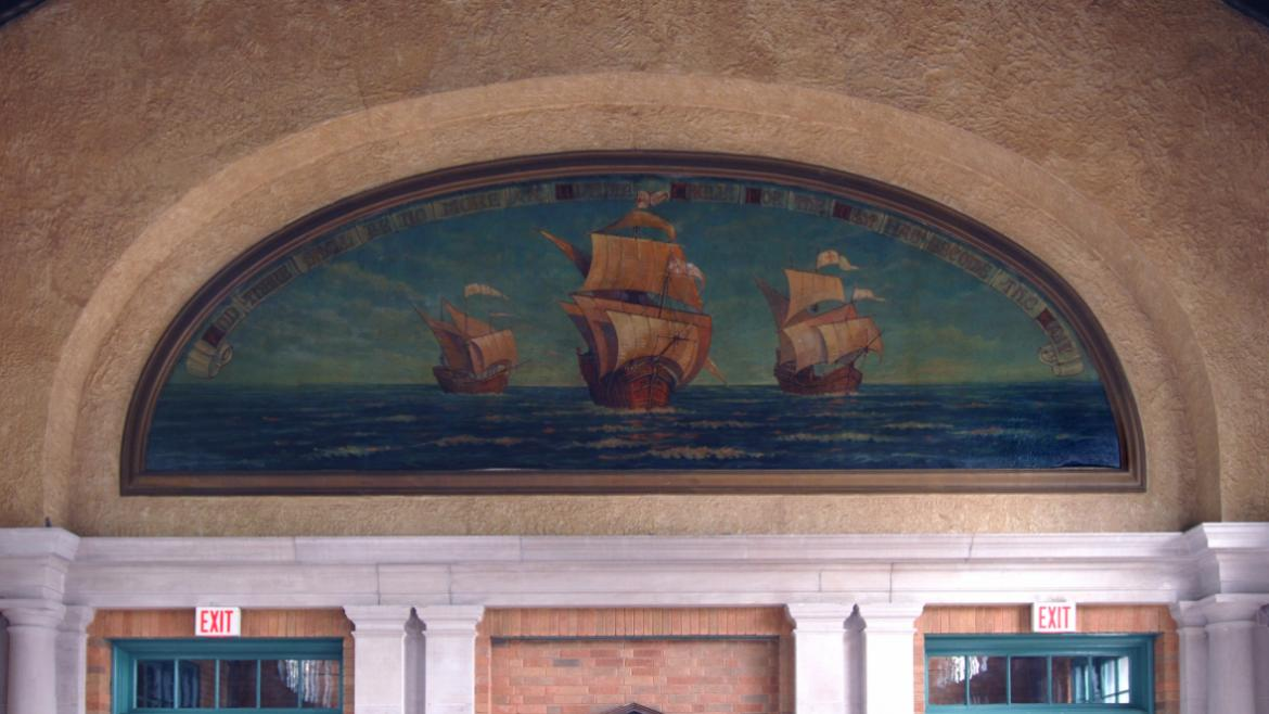 Depicting the three famous Columbus ships, the mural includes an arched scroll with the inscripton ""