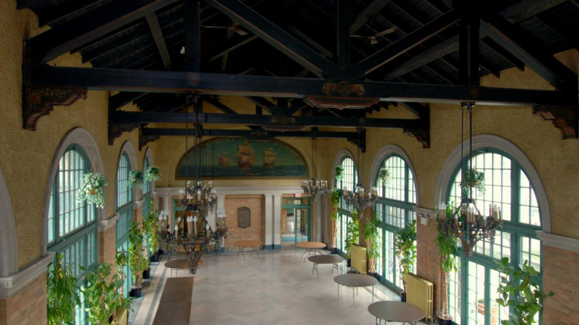 In addition to the mural, Roy L. Terwilliger painted the Great Hall's decorative beams.