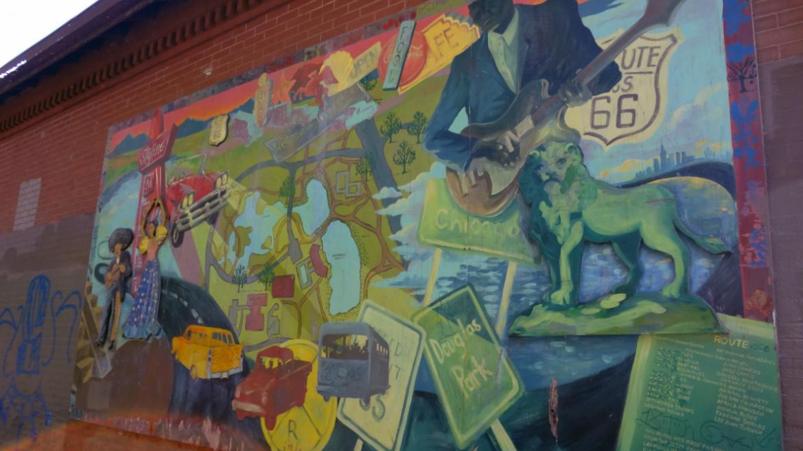 The large mural depicts vintage road signs as well as a map and other imagery relating to Douglas.