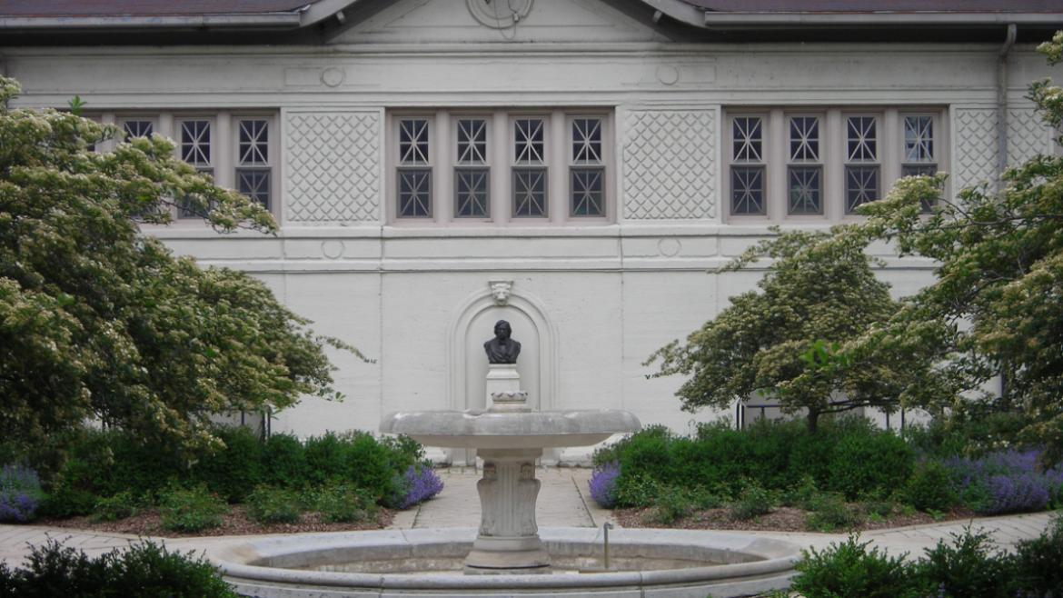 Located in the courtyard, the Melville W. Fuller Bust sits under a blind arch in the fa