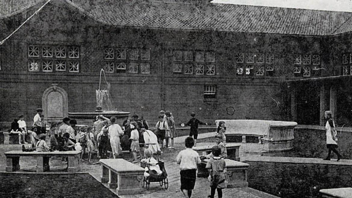 This photograph shows children playing in the Fuller Park courtyard near the original fountain, CPD