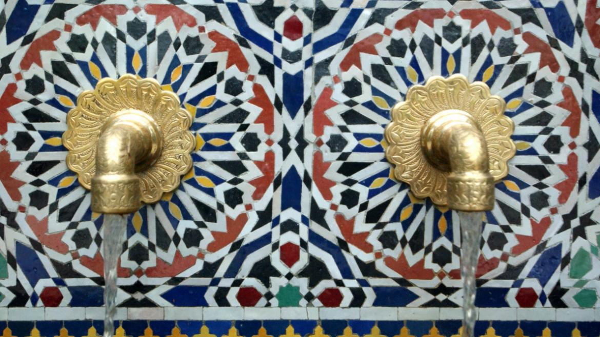 This close up of the Zelij Fountain shows its colorful tilework and lovely water spouts, 2009.