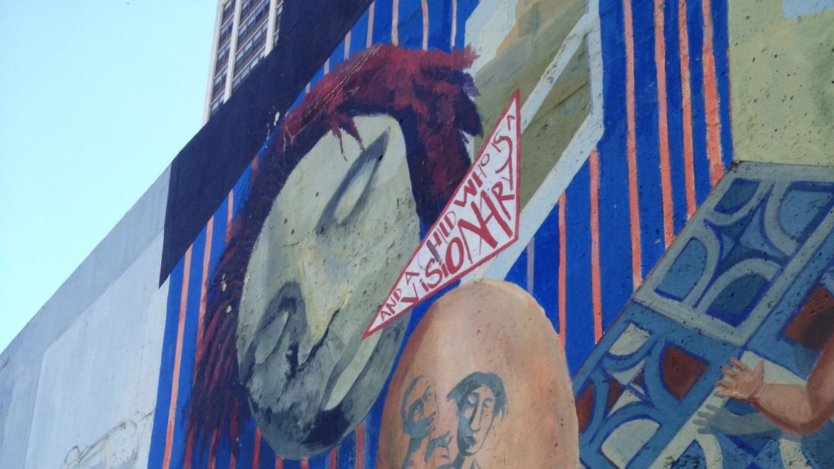 The mural, which has layers of imagery, emphasizes the strengths and abilities of women.
