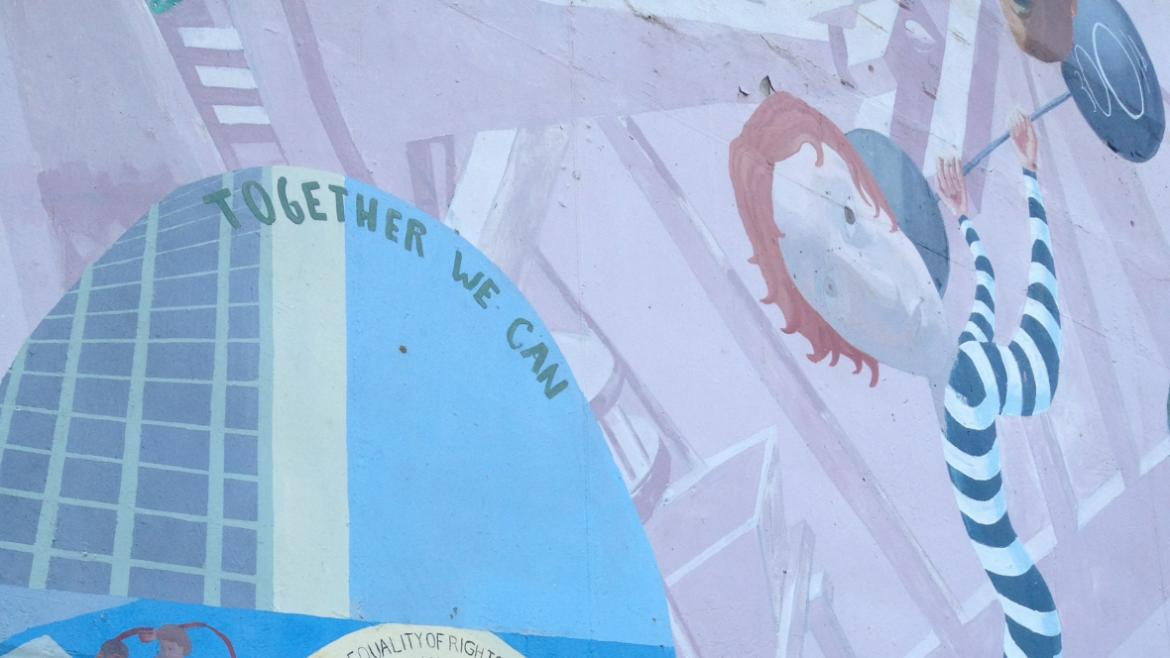 The mural depicts women involved in numerous activities and has text referring the equal rights.