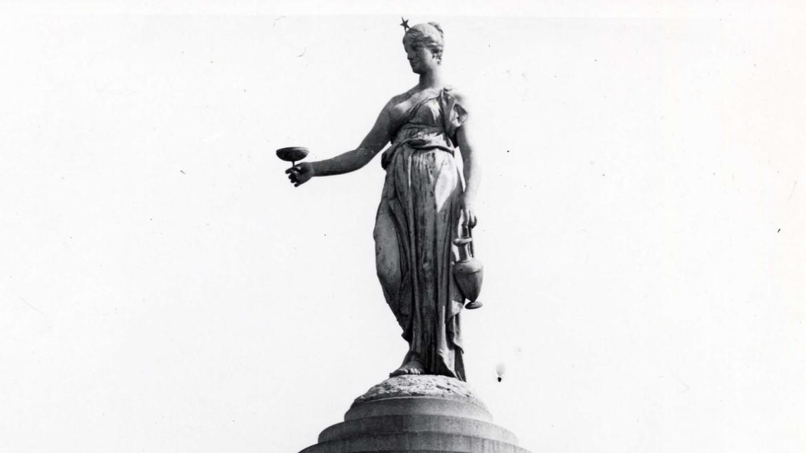 A sculpture of Hebe, goddess of youth and cupbearer to the gods, tops the Rosenberg Fountain.