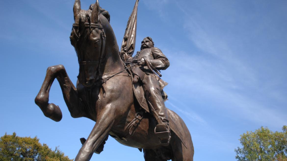 When a war hero is portrayed on a horse with one leg raised, it often signifies that he was wounded
