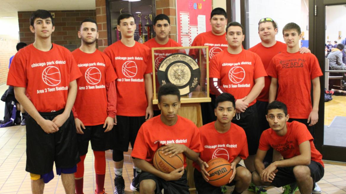 Hollywood Park Teen Basketball team checks out the Gold Medal.