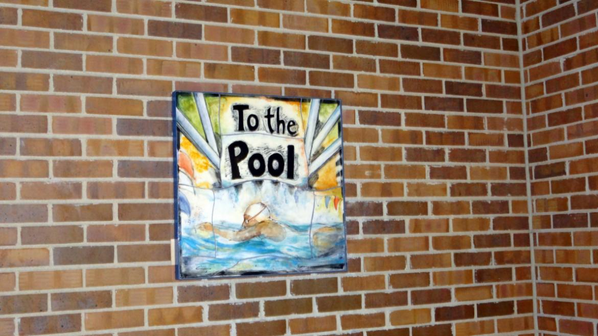 In the Swimhas several ceramic panels including this one that serves as a directional sign leading.