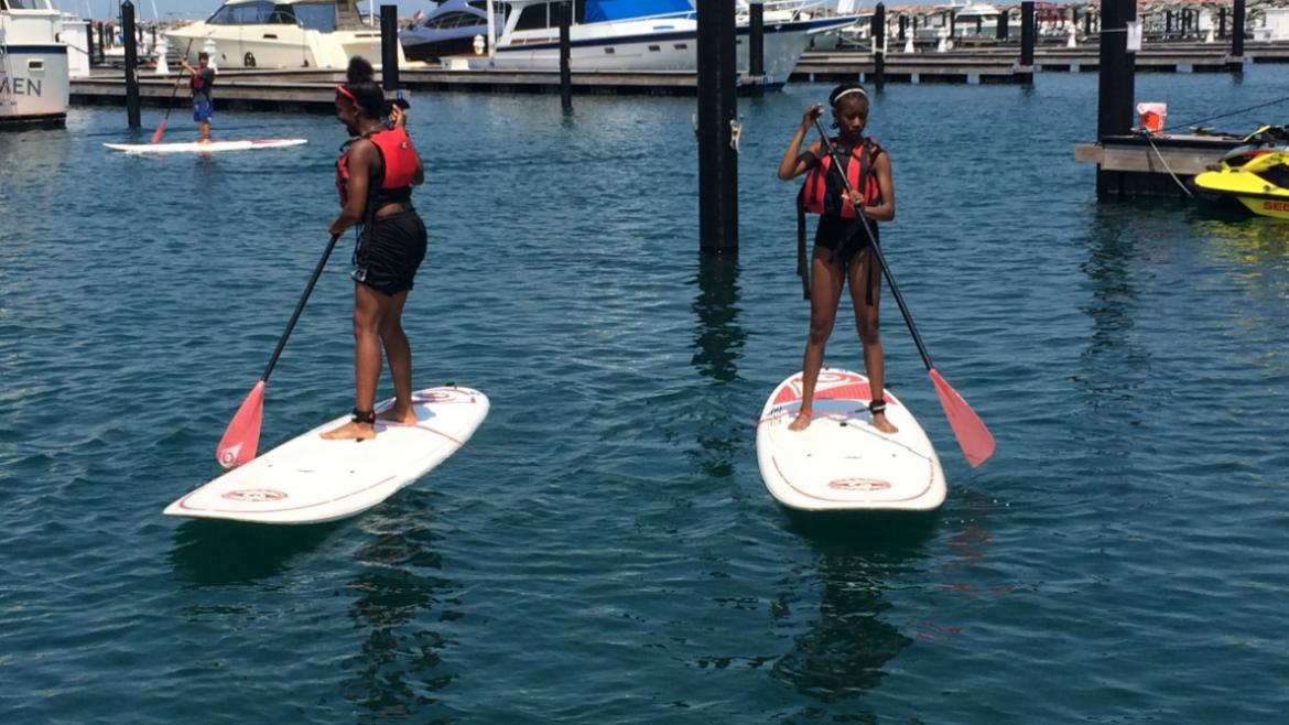 Teens paddleboarding at 31st Street Harbor