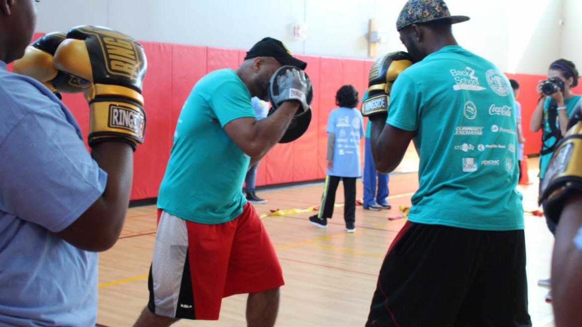 Boxing Instructor demonstrates how to protect yourself in the ring