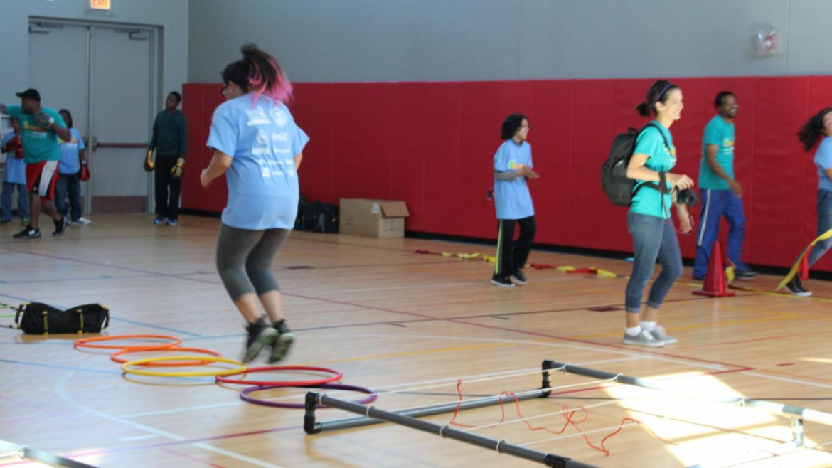 Power-Up teens running the obstacle course