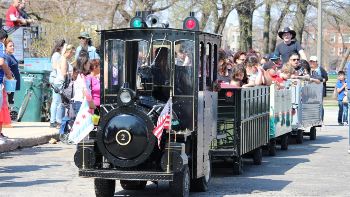 Riding the train around Humboldt Park at the Bunny party