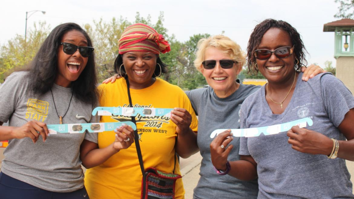 Chicago Park District staff handed out solar viewing glasses from Adler Planetarium
