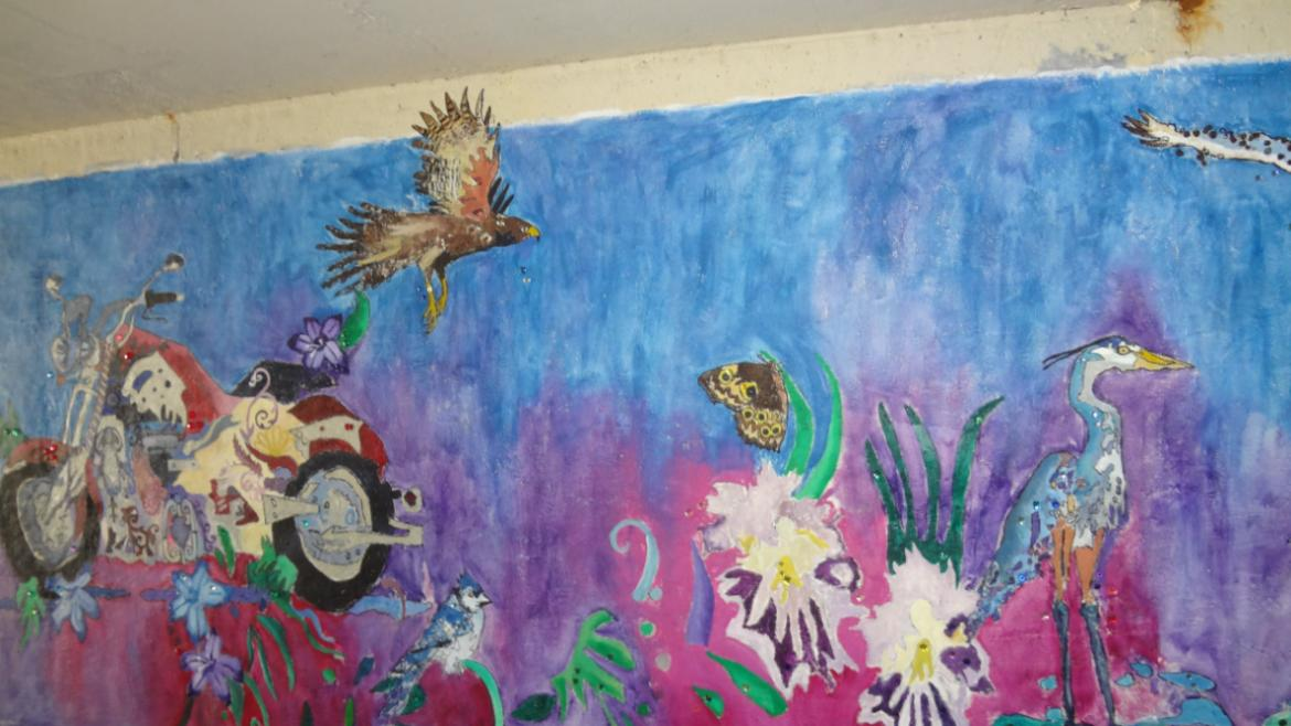 Artist Rachel Slotnick painted the mural on the north wall to deal with her grief after one.