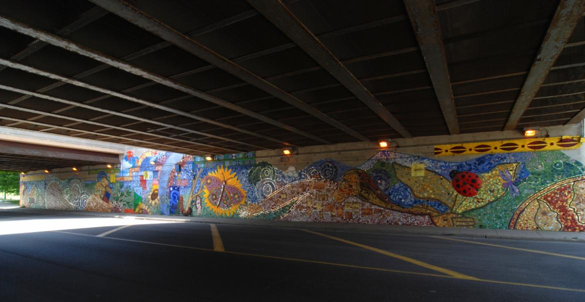 This view of the south wall shows Growing, the second mosaic completed in the underpass, 2012, photo