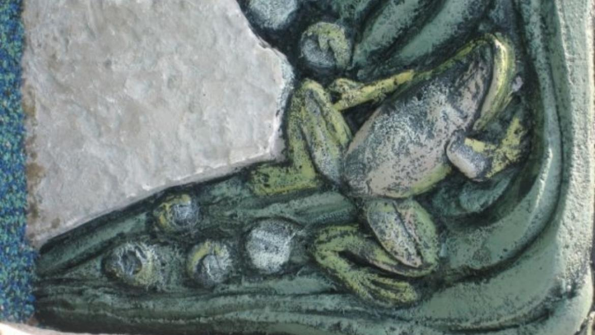 The Roscoe Playground includes colorful details made of concrete sculptural relief such as this frog