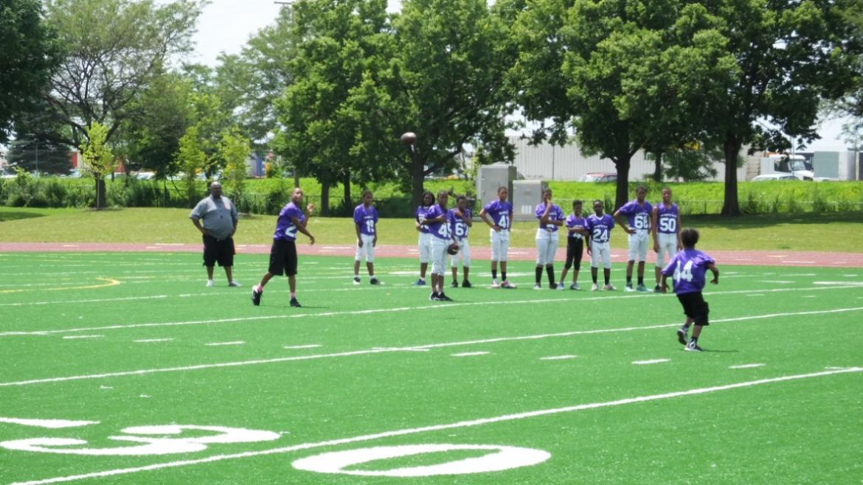 football team doing warm up drills