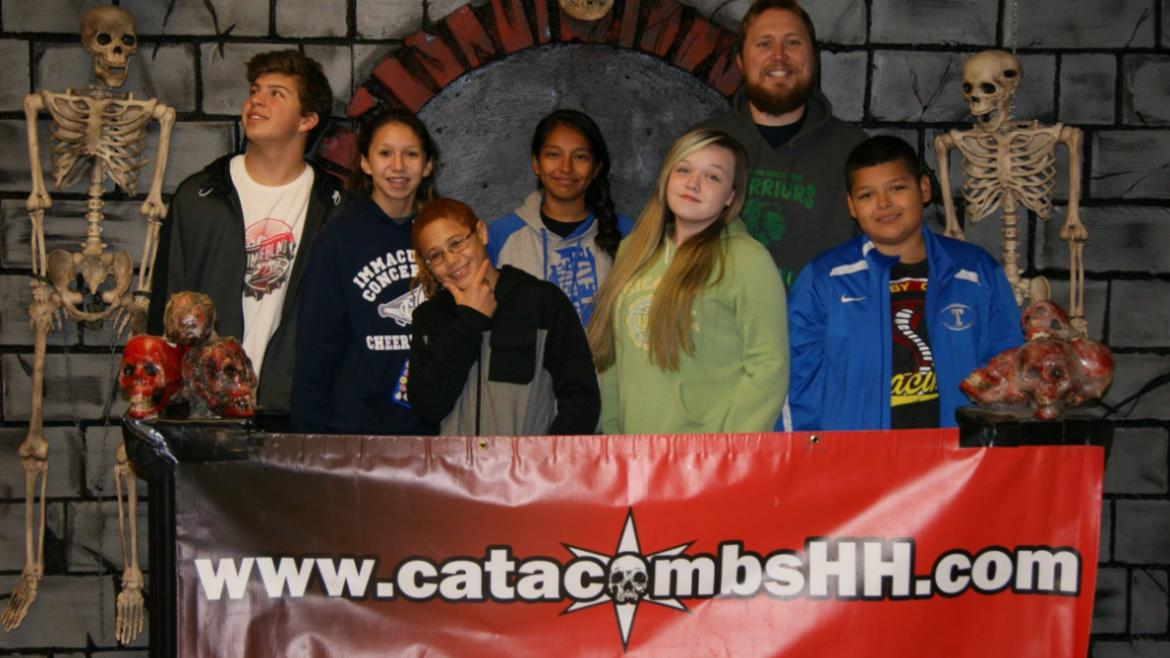 Our teens from Merrimac Park visiting a local haunted house. Group pic.