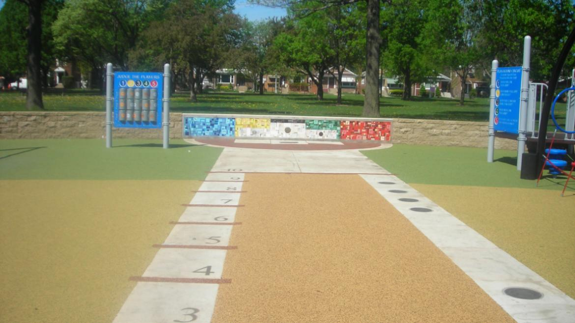 The long-jump component has bronze medallions commemorating U.S. Olympic and Paralympic world record