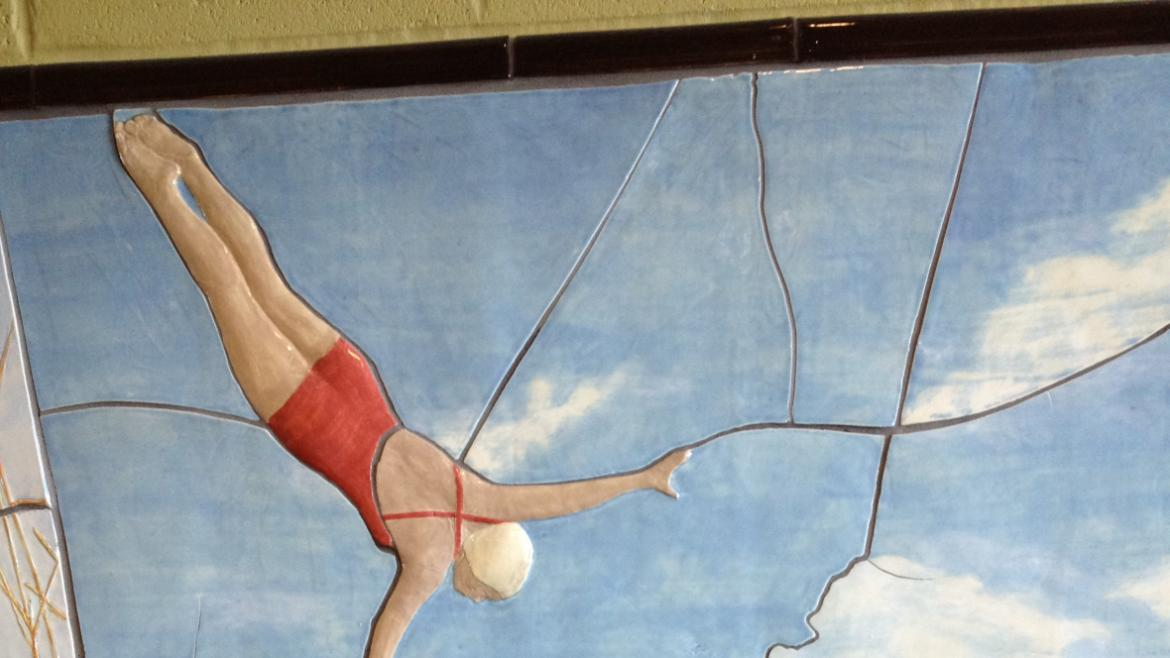 The artists included iconic aspects of Portage Park's identity by including a swimmer diving