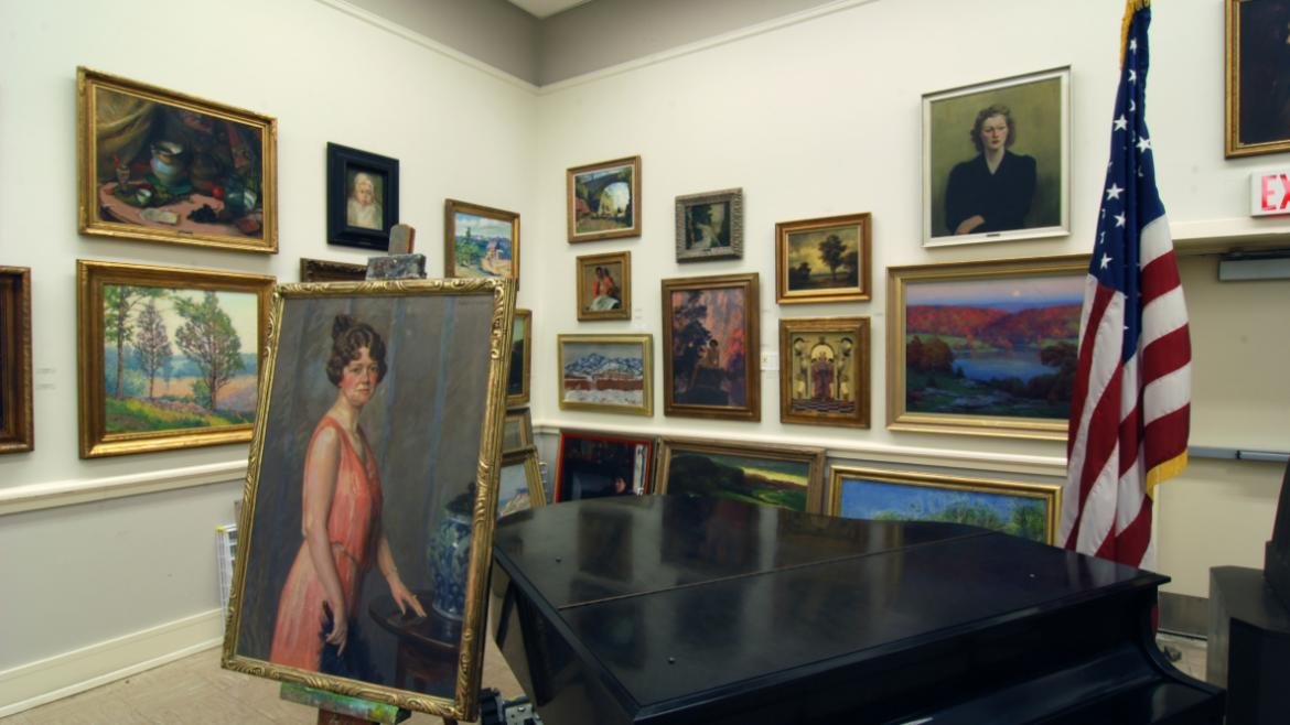 In the center of the wall behind the piano are two paintings by Maxfield Parrish, Solitude Temper