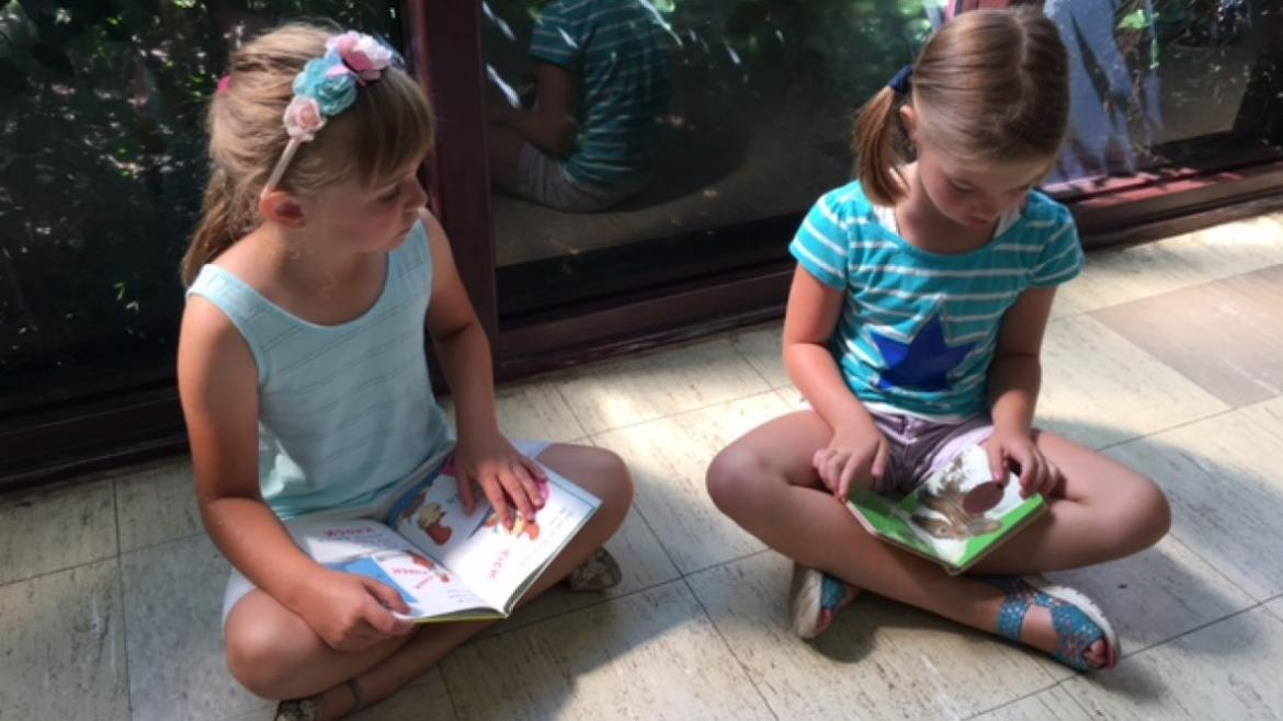 Smith campers celebrating National Book Lovers Day