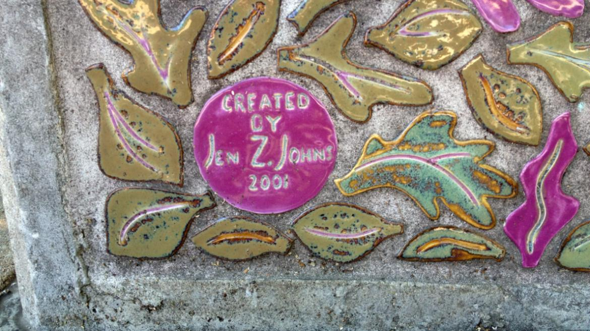 The artist's name, Jen Z. Johns, is inscribed in one of the pink medallions, 2012.