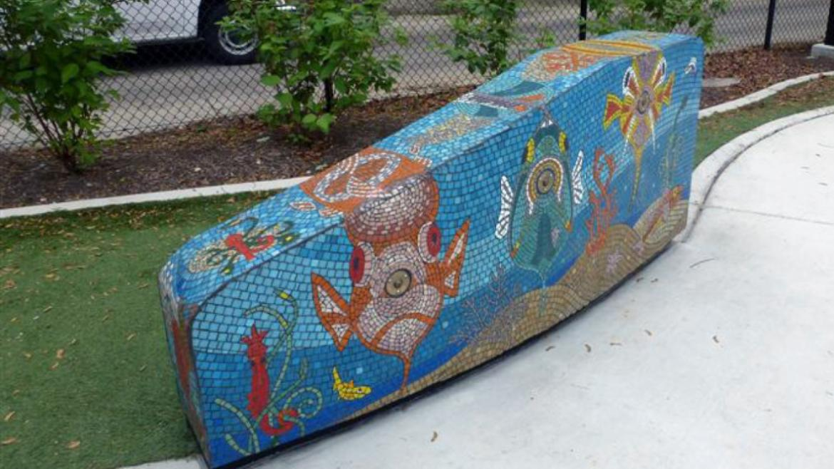 Following a sea life theme, the mosaic enlivens all of the concrete surfaces of the water spray