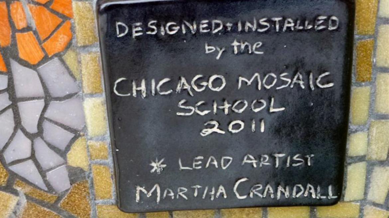 The tile that recognizes artist Martha Crandall looks like chalk on a blackboard, 2011.