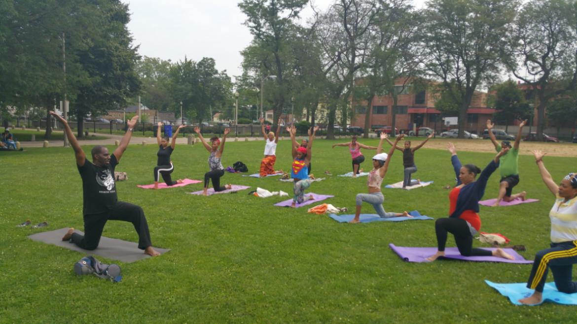 Master Kemetic Yoga Instructor Yasir Ra Hotep leads a yoga class on July 11 at Fuller Park!