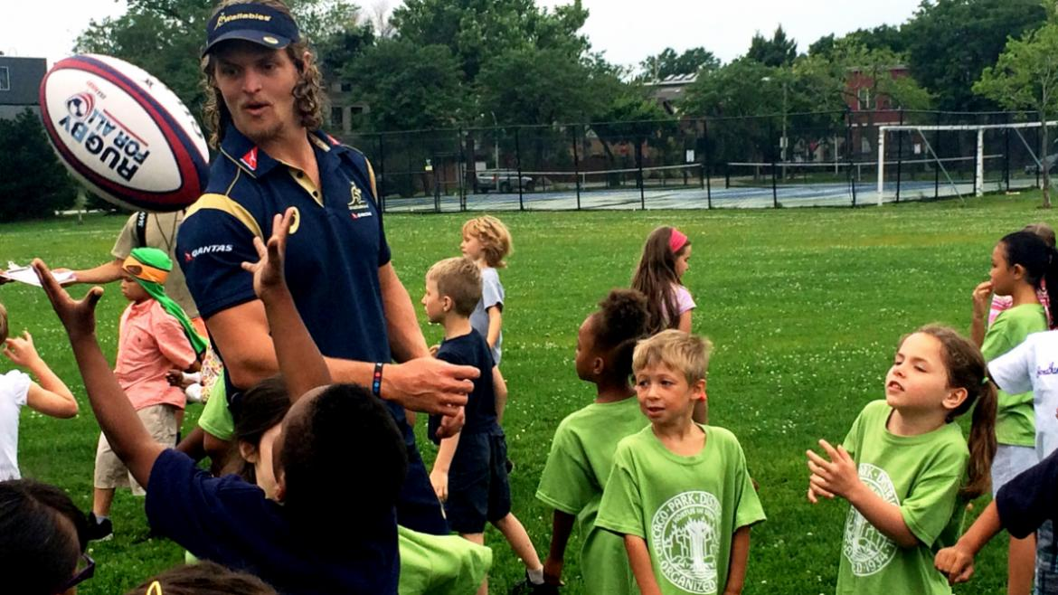 Wallabie Team players show Smith campers how to toss the ball
